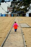 Young child walking away Stock Photography