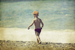 Young child walking on the beach Royalty Free Stock Photography