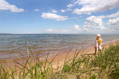 Young Child Walking on Beach Along Lake Superior Stock Photo