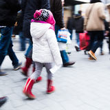 Young child in the walking crowd Royalty Free Stock Photography
