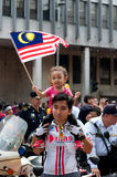 Young Child Waving a Malaysian Flag Royalty Free Stock Photo