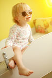 Young child wearing sunglasses indoor Stock Images