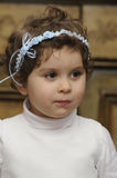 Young child at a wedding. Smiling young flower girl at a wedding after she got a mouthful of cake stock photo