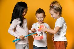 Children brushing their teeth with a toothbrush denture denture toothbrush jaw. Group of children brushing their teeth with a toothbrush denture denture royalty free stock image
