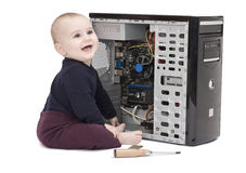 Young child wit screwdriver and ram Royalty Free Stock Photography