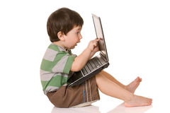 Young child, working on computer Stock Photo