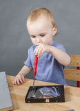 Young child working at open hard drive Royalty Free Stock Image