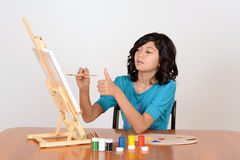 Young child working on painting Royalty Free Stock Photos