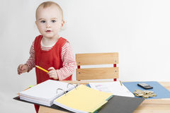 Young child at writing desk Stock Photos