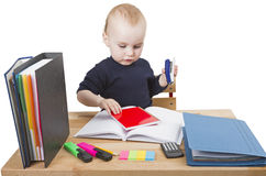 Young child at writing desk Stock Photo