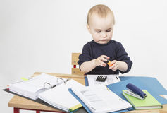 Young child at writing desk Royalty Free Stock Photo