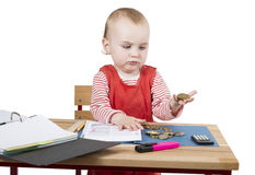 Young child at writing desk Stock Image