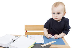 Young child at writing desk Stock Photography