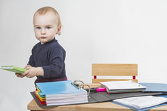 Young child at writing desk Royalty Free Stock Image