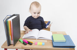 Young child at writing desk Royalty Free Stock Photos