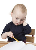 Young child at writing desk Royalty Free Stock Images
