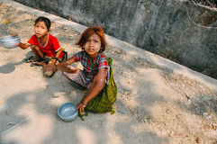 2 young children asking for spare change near Mount Popa. Royalty Free Stock Photos