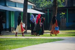 Young children of Bangladesh walking together finishing the final examination unique editorial photo. Bangladeshi children are leaving the school campus after stock photo