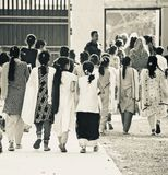Young children of Bangladesh walking together finishing the final examination unique editorial photo. Bangladeshi children are leaving the school campus after stock images