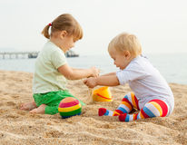 Young children on beach royalty free stock photos