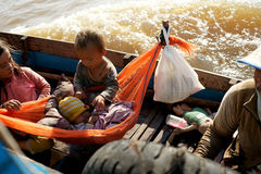 Young children in the boat.Tonle Sap Lake. Cambodia. Stock Photos