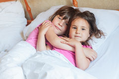 Young children - boy and girls - sleeping in bed at home, indoor Royalty Free Stock Photo