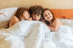 Young children - boy and girls - sleeping in bed at home, indoor Stock Photography