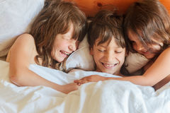 Young children - boy and girls - sleeping in bed at home, indoor Stock Photo