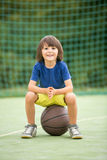 Young children, brothers and their father, playing basketball Stock Photography