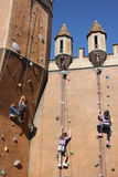 Young children climbing castle walls Stock Photo