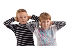 Young children covered their ears Stock Images