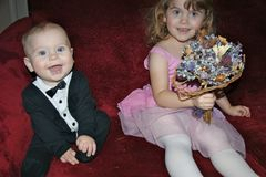 Young children dressed up to play getting married Royalty Free Stock Photo