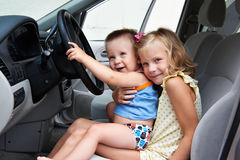 Young children are driving big cars Royalty Free Stock Photography