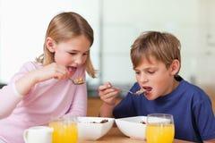 Young children having breakfast Stock Photo