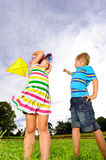 Young children having fun with their kite royalty free stock photo