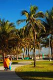 An unusually brisk morning in Miami Beach. Young children keep bundled on an unusually brisk morning in Miami Beach royalty free stock images