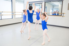 Young children laughing during dance class. Young ballet dancers in class Stock Photos