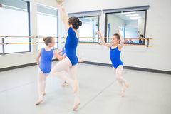Young children laughing during dance class. Young ballet dancers in the studio Royalty Free Stock Photography