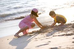 Young children making sand castle Stock Photography