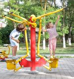 Young children on outdoor sport ground / gym Royalty Free Stock Photos