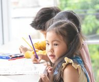 Young Children painting in art classroom. Young Children are painting in art classroom stock images