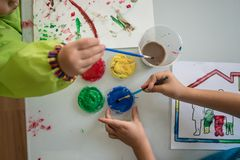 Young children painting with colourful acrylics Stock Image