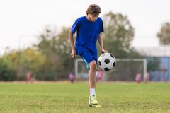 Young children player on the football match field stock photos