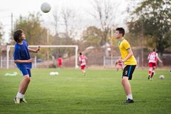 Young children player on the football match field royalty free stock photography