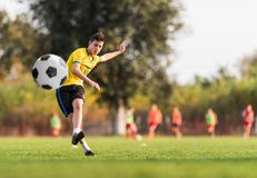 Young children player on the football match field stock photography