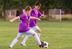 Young children players football match on soccer field Royalty Free Stock Image