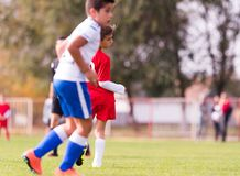 Young children players football match on soccer field Stock Photos