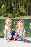 Young children playing near the lake and forest. Concept childho. Od, lifestyle, vacation, travel Royalty Free Stock Images