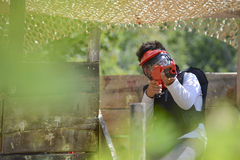 Young children playing paintball Stock Photography