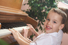 Young Children Playing the Piano Stock Images
